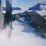 Ice 06 – Antarctica – Reviewing Ice Fields for Landing Sites against Sat Imagery amongst Mountains in Northern Victoria Land, from a C-130.